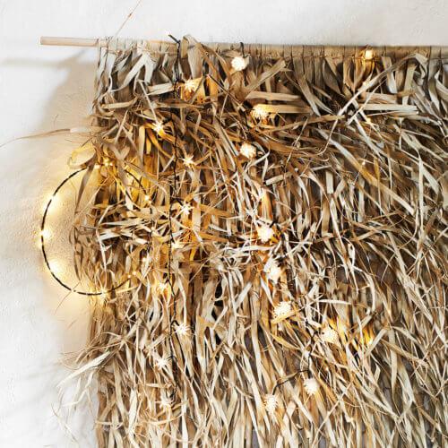 Madam Stoltz Wand-Dekoration aus Palmenblätter